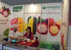 Ms Stacy Hemmasart of Kodanmal Group Co., Ltd. is receiving a visitor at the booth. The company supplies a variety of fresh fruits from Thailand.