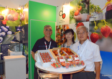 Mr Jim NG (left) of Bubble Gum International Ltd and his Japanese suppliers. The company imports fruit jam, strawberries, tomatoes, peaches, frozen blueberries and apples from Japan.
