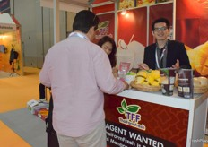 A sales representative from TFF ThaiFarm Fresh. The company supplies a wide range of exotic fruits from Thailand, including coconut, dragon fruit and mango.